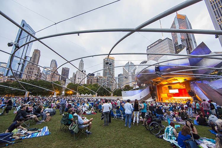 Stars of Lyric Opera at Millennium Park - A crowd watches an opera concert from the lawn of the Jay Pritzker Pavilion in Chicago.