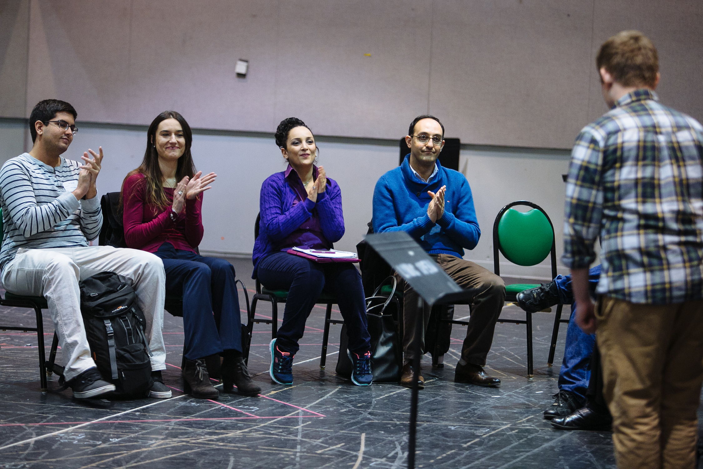 Artists clapping in rehearsal space