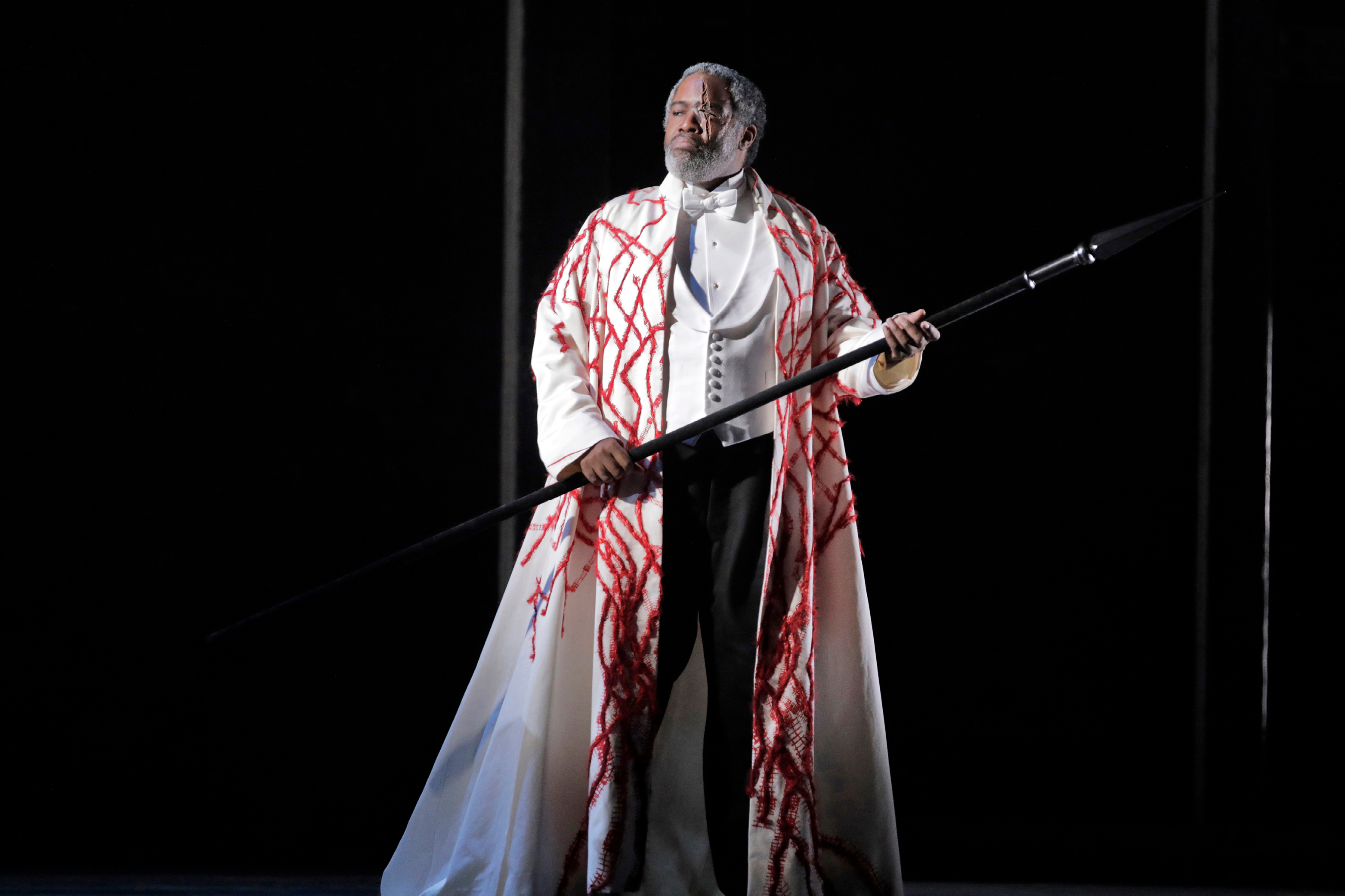 Eric Owens as Wotan on stage holding spear