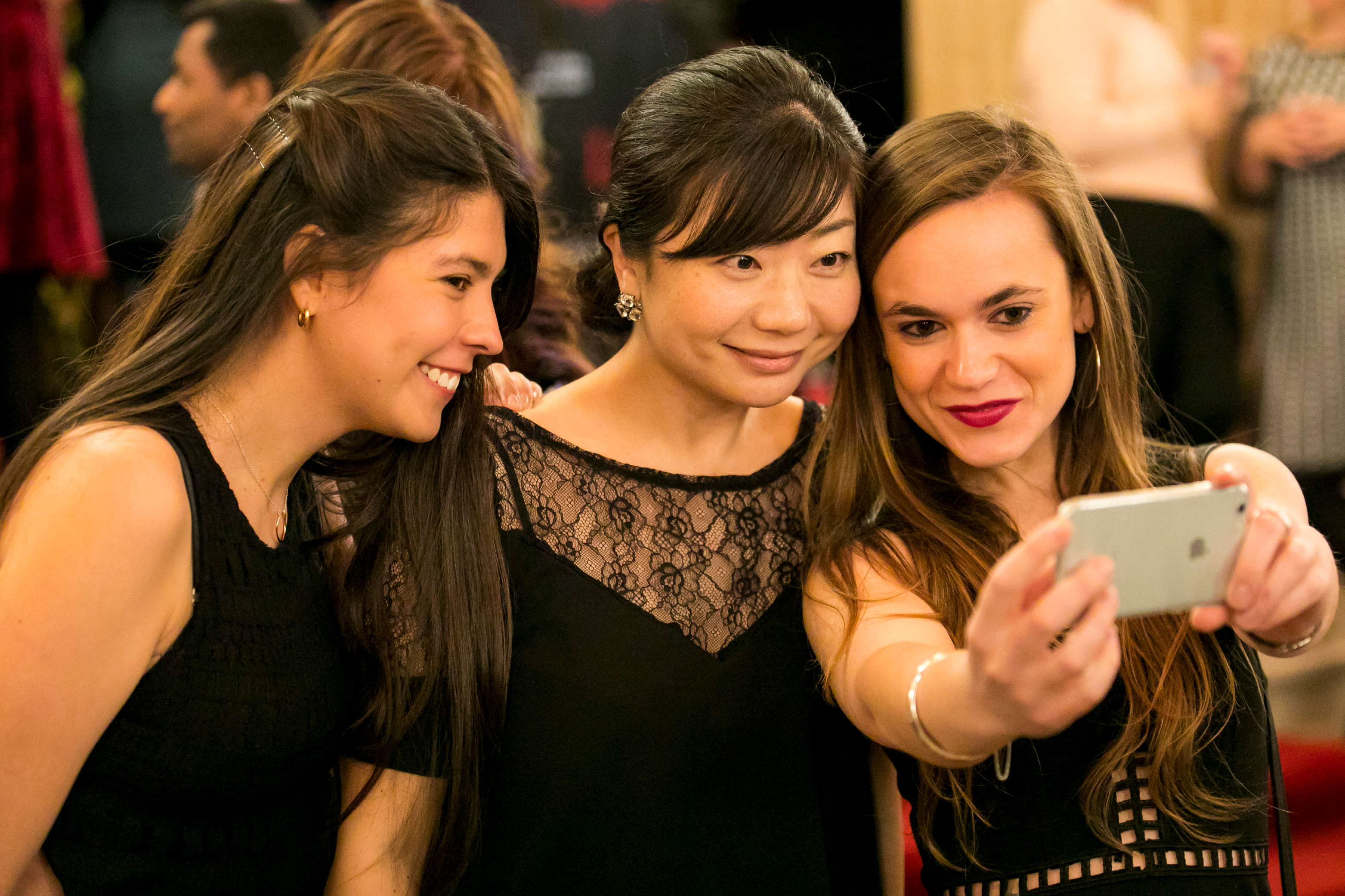 Young patrons taking a selfie in the grand foyer